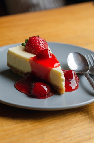Strawberry Cheesecake with spoon and fork